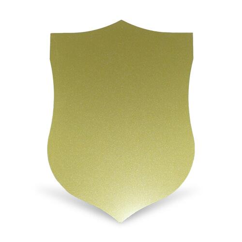 Arany színű, pajzs alakú acéllap szublimáláshoz, préseléshez